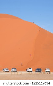Sossusvlei/Namibia - June 2, 2018: Tourists are hiking the Dune 40 in Sossusvlei, Namibia.