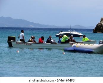Sosua / Dominican Republic - July 2019:  Tourists on a speed boat in Sosua beach