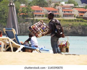 Sosua / Dominican Republic - July 26, 2018: Haitian vendor selling sunglasses on the beach