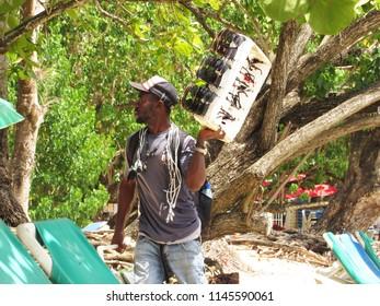 Sosua/Dominican republic - July 26, 2018: Haitian beach vendor of sunglasses