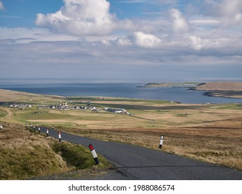 From Sother's Field, a view across Valsgarth and Clibberswick with the water of Harold's Wick, the hill of the Keen of Hamar and the island of Balta appearing on the right - Unst, Shetland, UK