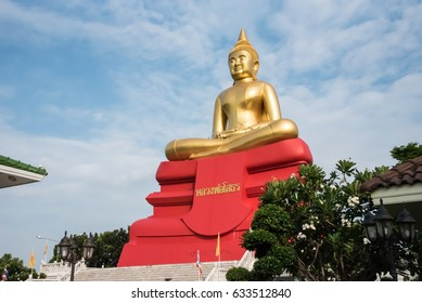 Sothon pastor Sothon bishop a statue with red base and Thai languate is Laung Por Sothon a name of statue.