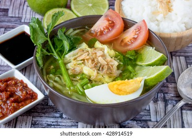 Soto Ayam is a traditional Indonesian soup mainly composed of broth, chicken and vegetables.