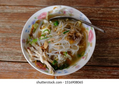 Soto Ayam is a traditional Javanese chicken soup with clear soup. made from chicken, spices, chicken stock, boiled bean sprouts, vermicelli and a sprinkling of fried shallots. Indonesian food.