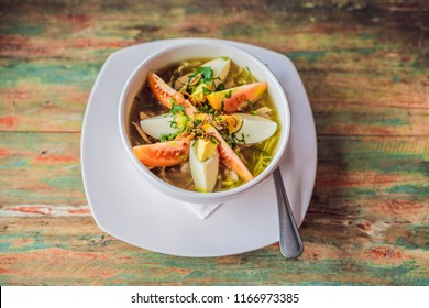 Soto is a traditional Indonesian soup mainly composed of broth, chicken and vegetables