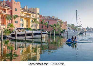Sotogrande, Costa del Sol, Andalusia, Spain - September 28 2019: Port of Sotogrande. Port, sea, yachts and colorful houses and jet ski