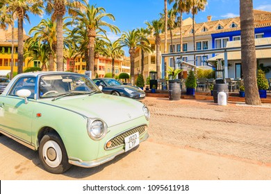 SOTOGRANDE MARINA, SPAIN - MAY 8, 2018: Classic retro Italian car parking on street in front of a restaurant in Sotogrande yacht port. Costa del Sol is famous tourist destination on Iberian peninsula.