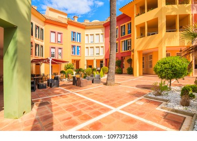SOTOGRANDE MARINA, SPAIN - MAY 8, 2018: Beautiful colorful houses and apartments in Sotogrande yacht port, Costa del Sol, Spain is popular holiday destination in Europe.