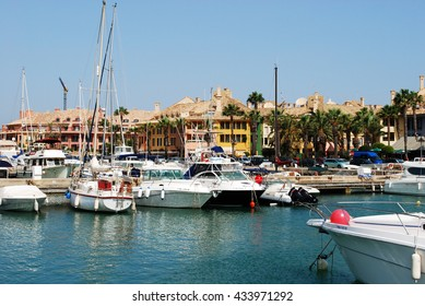 SOTOGRANDE, SPAIN - JULY 18, 2008 - Yachts and boats in the marina with buildings to the rear, Puerto Sotogrande, Cadiz Province, Andalucia, Spain, Western Europe, July 18, 2008.