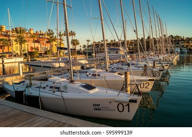 SOTOGRANDE, SPAIN - March 1, 2017: Boats and yachts at pier in Sotogrande Port, Andalusia, Spain on March 1, 2017