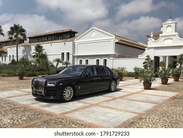 Sotogrande/Spain - August 10 2017: Large black luxurious car in front of a picturesque building