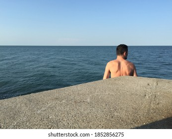 Sottomarina, Chioggia Italy - 07/2020 - Man watching the sea horizon