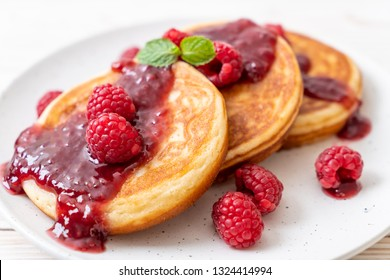 souffle pancake with fresh raspberries and raspberry sauce