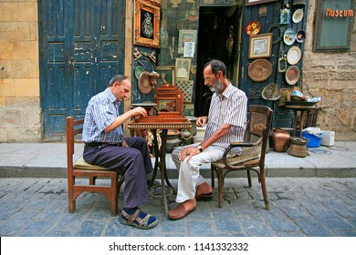 Souk Khan el-Khalili district, Cairo / Egypt -  October 19 2016:  Two man playing backgammon outside a cafe in Downtown Cairo, Souk Khan el-Khalili, Cairo, Egypt