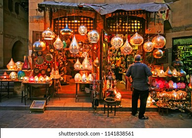 Souk Khan el-Khalili district, Cairo / Egypt -  October 20 2016:  Shop and man in front of the shop at dusk in the Souk Khan el-Khalili (bazaar or market), Cairo, Egypt