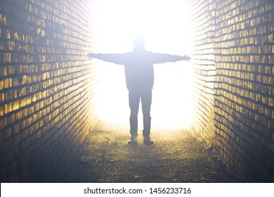 Soul of deceased man. After death, the light at the end of the tunnel.