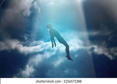 Soul of deceased man taken up into heaven. Afterlife, meditation and dream concept