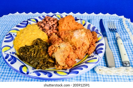 Soul Food supper in blue gingham Southern Cooking setting.
