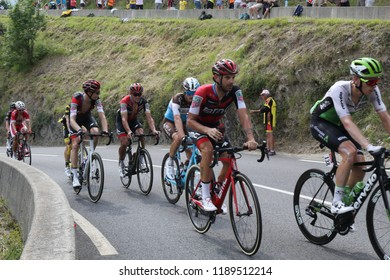 Soulan, France - July 25, 2018: Julien Vermote, Damiano Caruso and other cyclists climbing during the Tour de France 17th stage in Soulan