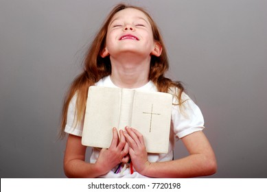 Soulful Young Girl Holding Bible