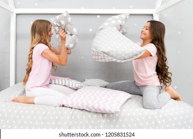Soulmates girls having fun sleepover party. Pillow fight pajama party. Sleepover time for fun. Best girls sleepover party ideas. Girls happy best friends in pajamas with pillows sleepover party.