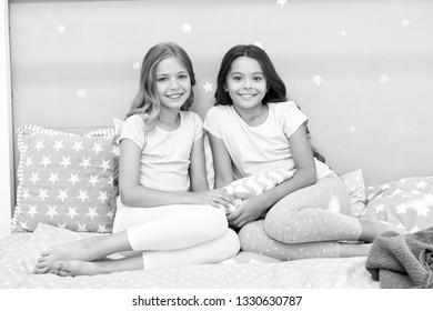 Soulmates girls having fun sleepover party. Childhood friendship concept. Girls happy best friends sleepover domestic party. Sleepover time for fun gossip story. Best girls sleepover party ideas.