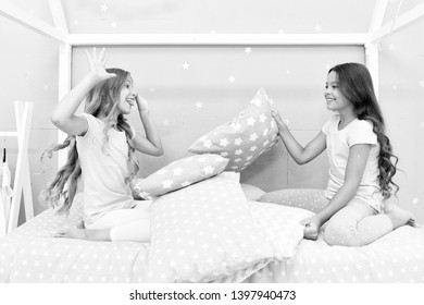 Soulmates girls having fun sleepover party. Girls happy friends with cute pillows. Pillow fight pajama party. Sleepover time for pillow fight. Doing whatever they want. Girls sleepover party ideas.