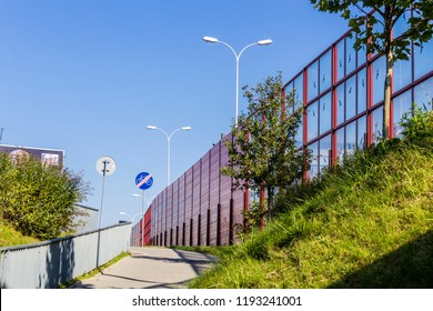 Sound absorbing screens along the highway and bike paths.Metal frames filled with glass.Figure black birds on the glass.Modern technology in Poland.