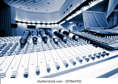 sound board and microphones in the concert hall.