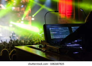 Sound engineer at the console at the concert