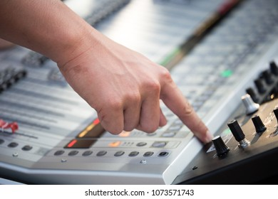 sound engineer hands working on digital sound audio mixer and amplifier equipment, studio music recording concept