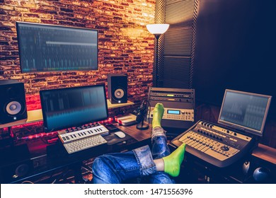 sound engineer, music producer sitting cross-legged and listening final mixdown music in home recording studio
