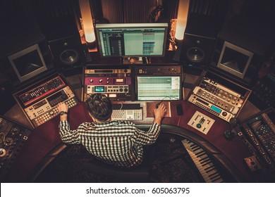 Sound engineer working in boutique recording studio