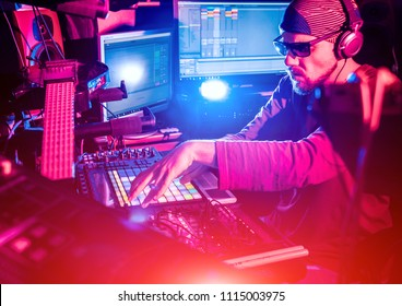 Sound engineer working at mixing panel in the in sound recording studio. Modern background