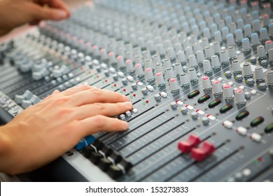 Sound engineer works with sound mixer, hands close-up