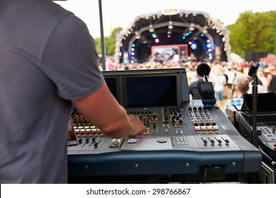 Sound and lighting engineer at an outdoor festival concert