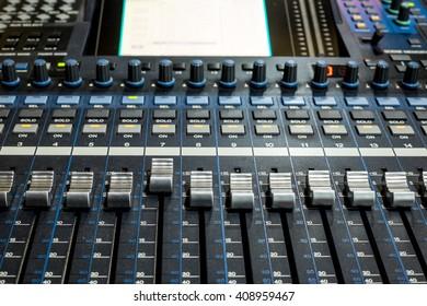 Sound mixer (fader, EQ, control) in studio