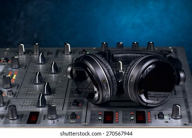sound mixer with headphones resting on the top