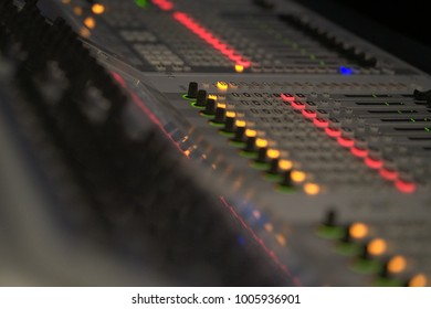 Sound mixer panel in a recording studio .