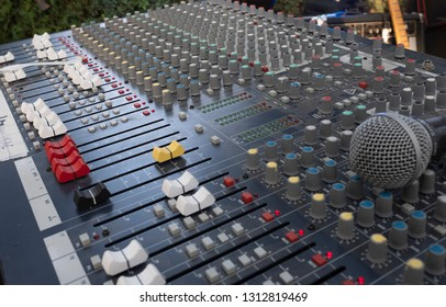 sound mixing table for a concert with microphone