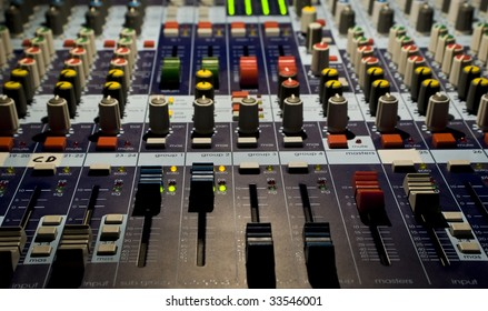 Sound producer mixer. Faders of channels and regulators. Close-up