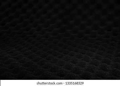 Sound proof padding acoustic soft foam black color double thick panels layers on the recording studio wall for reduce or absorb or protect this room from other falsetto outside for professional works.