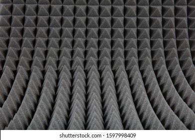 Sound proof padding acoustic soft foam grey color double thick panels layers on the recording studio wall for reduce or absorb or protect this room from other falsetto outside for professional works.