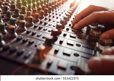 Sound recording studio mixing desk with engineer or music producer