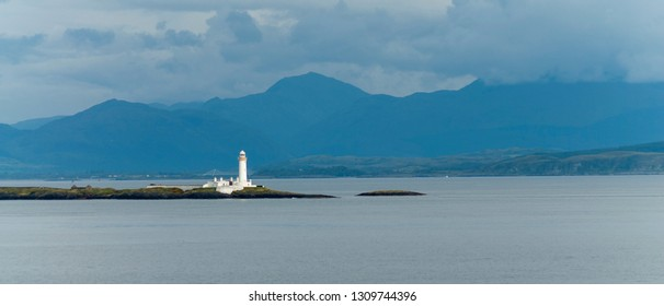 Sound of Sleat towards Kerrera Island and Oban, showing the Lismore Islands and the lights of Lady Rock and Eilean Musdile taken from near Gorten on the Isle of Mull, Scotland, UK