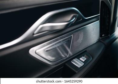 Sound speaker in a modern car door panel