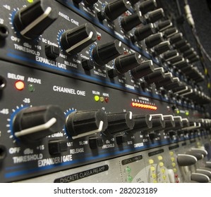 sound studio adjusting record equipment console sound engineer