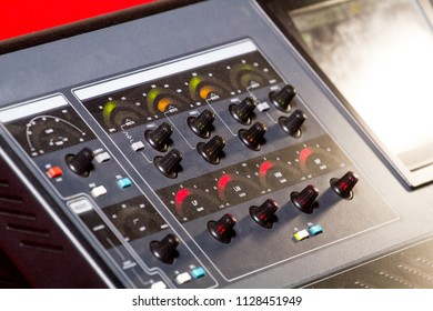 Sound technician and lights technicians control the music show in night club.Professional audio, light mixer controller panel.Pro equipment for concerts.Stage lighting control