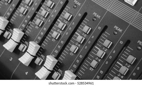 the soundboard in the Studio, working with sound, professional equipment for music. Film texture & unfocused