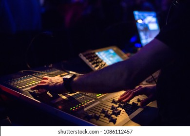 Soundman working on the mixing console.